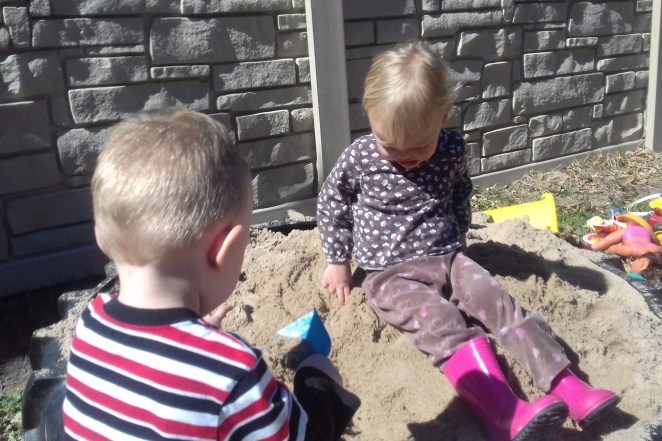 two kids in a sand box